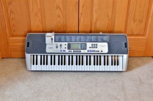 Casio LK-100 61-Key Electronic Piano Musical Keyboard - Lighted Keys