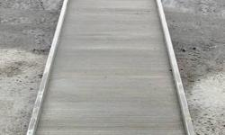 A Magliner 16' aluminum slider ramp. Used for trailer walk ramp but has many other uses. Use it for your shed, a ramp or dock plank for your camp, a ramp for a deck, ect. The end bar with rollers has been cut off. I still have the carrier if wanted. $250
