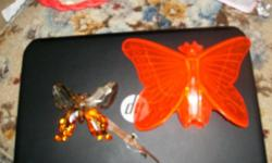cleer site red-orange butterfly with ladies face, was told bought at gas stations in the 50s. comes with origional hardware and box in good condition. clear one not for sale. just example what it looks like on my car. no nostalgic or remiscience emails