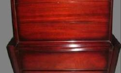 This is an absolutely stunning piece. Must see in person. Clean-lines, mid century modern aesthetic featuring bold, broad-beveled framing. Made by Tri-Bond Furniture in 1958. The mahogany has a deep red color. In excellent condition and extremely well