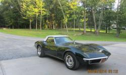 1968 Corvette convertible, rebuilt motor, new tires, new white top, new muffler. Has power steering,garage kept and much more.