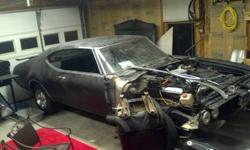 I have a 1969 Olds Cutlass w/ #'s matching suped up 350 Rocket Engine and a spoiler. Also have a hard to find dual exhaust rear bumper for this car (correct light slots )...brand new. Additional items include extra glove box and center mount console. I