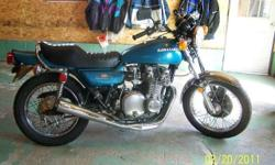 1974 Kawasaki Z1A 900cc, low miles 2281, New Vance Hines 4 in 1 exhaust, Dyna ignition, Pod Filters, LTD Style seat on original seat pan. Everything else expect paint is stock Matching Numbers Z1F-22721 and Z1E-22795. Motorcycle went down on gravel