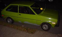 THIS IS A 1980 FORD FIESTA.THIS HAS JUST UNDER 86,000 ORIGINAL MILEAGE CAR.I AM ONLY THE SECOND OWNER ALWAYS IN THE HUDSON VALLEY NY IT'S ENTIRE LIFE.THIS IS A 4 SP CAR.THIS COMES WITH NO AC.THE FIESTA NEVER WERE BUILT TO HAVE AC.THIS HAS GOOD ROLL UP