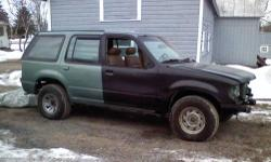 2000 Explorer with 1997 Limited body. Yes only 3900 miles. Evergreen Frost Metallic with tan leather interior. V6 Auto. Bought as a project, in the process of repainting. Many new parts, new NAPA battery, new transponder keys, runs and sounds like new.