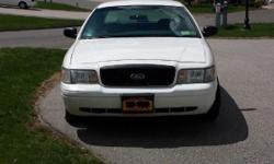 2001 Ford Crown Victoria Interceptor white from the NY Fire Department fleet. This full sized sedan runs and drives excellent. It has a very powerful 8 cylinder, 4.6 liter engine with an automatic transmission, light blue cloth interior, power brakes,