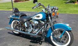 2001 Harley Davidson in Excellent Condition Great shape with only 25,482 miles and plenty of chrome with its eye catching Teal Blue and Peal White finish The Heritage Springer was introduced in 1997 and ended production in 2003 which has placed these