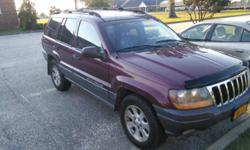 Looking to sell my 2001 Jeep Grand Cherokee Laredo to help with wedding expenses. It is a 6-Cyl vehicle with an automatic transmission. The back hatch was replaced, so it is a slightly different color than the rest of the car (the pictures won't upload