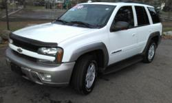 This 2003 Chevrolet TrailBlazer LTZ is clean inside and out, runs strong with its 6-Cyliner 4.2L VORTEC engine and gives all weather versatility with electronic 4-Wheel Drive. Comes with leather seating, CD stereo, power options, tinted windows and more!