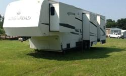 Stock Number: 722617 . 2004 King of the Road 5th wheel camper. Center kitchen layout creates private bedroom and bathroom. Bedroom has slider to create more room with push button retract feature, queen size bed, large 10' closet, built in dressers (10