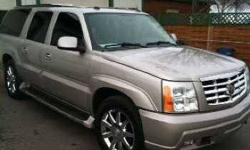 2004 Cadillac Escalade ESV This SUV currently has 96,140 miles and in great condition Platinum Grey Metallic exterior and with a premium Cream leather interior Equipped with a V8 automatic transmission with Overdrive technology Standard features include a