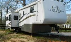 "2004 Double Tree Mobile Suites M 36TK3 36Ft 5th Wheel **Top of the line** All Season 3 Slide Outs, 3 1/2"" walls will R13 insulation!!! Central AC Front Power Leveling Jacks Included. Convection Oven/Microwave 32"" Flat Screen TV Surround Sound Sofa bed"
