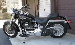 "2005 H.D. FLSTF ""Fatboy"", Always kept in a heated garage: Candy Black Cherry/Metallic Dark Grey; mint condition, low mileage, new tires and brake pads. Custom chrome additions tastefully done. Starts, rides and runs great. Engine modified by ""Dyno George"""