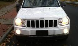 white 2005 jeep grand Cherokee 115k miles pioneer navigation, sunroof, leather headed seats 4x4 4.7L v8 very clean car, heat a/c work no check engine light just got a full tune-up on the car filter oils spark plugs please call chris 347-500-1342