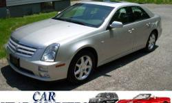 NAVIGATION!!! POWER GLASS MOON ROOF!!! HEATED MEMORY SEATS!!! REMOTE START!!! XM-SATILLIGHT RADIO!!! POLISHED ALUMINUM WHEELS!!! KEYLESS GO!!! LUXURY PKG WOOODGRAIN TRIM!!! HERE'S A SHOWROOM NEW 2006 CADILLAC STS-4 AWD LUXURY POWERED BY THE 3.6L V-6 THE