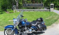 2006 Harley Davidson FLHRCI Road King Classic This Touring cycle currently has 3,450 miles and in great mechanical condition Black Cherry Metallic in color and with a premium Black Sundowner leather seat Equipped with a V2, 4 Stroke 1442.15 cubic