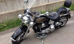 - 2006 Harley Davidson Deluxe in great shape. - Factory numbered paint set # 19 of 150. - Custom matching wheels and rotors. - Quick detachable windshield. - 1 1/2 fat Heritage handlebars. - Custom matching mirrors, floorboards, and shift linkage. -