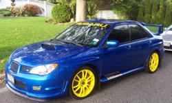 This is a 2006 Subaru STI. Currently it has 74,800 miles. Right now it has the yellow OZ rims with brand new Continental tires on it (225/40/zr18). It also comes with another set of OZ rims (with used tires). It's a stage 2 turbo 330 wheel hp (380