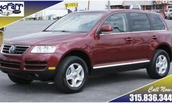 Be ready for any weather and any conditions on-road or off-road with this extra clean VW Touareg. This VW is in great condition inside and out. It is loaded with features including dual zone climate control, power moonroof, towing package, and much more.