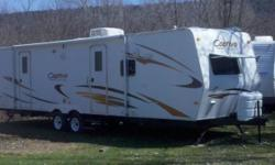 2007 Coachmen M-288 FKS. 13,500BTU central air, 22,000BTU furnace, Microwave, 6 gallon water heater, lp stove, gas/ electric fridge, TV antenna w/ booster, stabilizer jacks, auxiliary battery, 18' awning, upgraded cabinetry, LPG gas/smoke detector, 12'