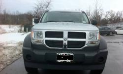 2007 Dodge Nitro SXT Sport Utility 4WD Engine : V6, 3.7 Liter Mileage : 56.000 Horsepower : 210 @ 5200 RPM Gas Mileage : City 15/Hwy 21 Transmission : 4 Speed Automatic Drive train : 4WD + 2WD (Rear) Traction Control, Stability Control, ABS (4-Wheel),