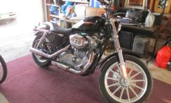 2007 Harley Davidson Sportster 883 Custom. Black. Saddlebags included. Low mileage. Approx. 3500 miles