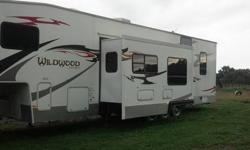 2007 Wildwood by Forest RiverXL Fifth Wheel Series M-376SRV Fully loaded Toy Hauler Travel Trailer used only to go to HITS three times Great Shape Priced to sell call 9144747722 2007 Forest River Wildwood 356 SRV, 36 foot toy hauler 5th wheel, super