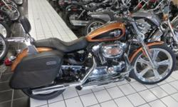 This is a really nice Anniversary 1200 Custom. CHECK IT OUT !!! Looks good, runs great, and it has a few add ons. Custom wheels, and chrome front lower legs to start with. Then you have a pair of custom grips, a set of slip on exhaust for sound, a pair of