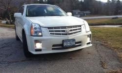 Clean Single Owner Cadillac SRX V6 AWD Leather Sunroof Remote Start Navigation Fully Loaded No Accidents New Tires White exterior with Beige Leather Interior, Heated Seats, We purchased this vehicle from Cadillac, recently purchased a new car and have no