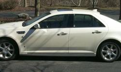 2009 STS Cadillac with AWD, sun roof, heated seats, lumbar hooked up for OnStar, CD changer for 6 cds. GPS and many more features. It is loaded. Beige Interior, leather seats. 4 door sedan. V6. It gets 25 miles a gal. and even better on long trips.