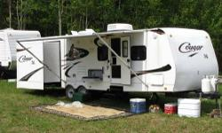 Length: 30 feet Year: 2009 Make: Keystone Model: Cougar X-Lite 30BHS Miles: NA Interior Color: NA Exterior Color: NA Slides: 2 30' Travel Trailer. This has room enough for 9 to sleep! Polar package for those cold nights (hunting season)! LCD TV, DVD