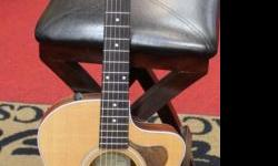 2009 model with handmade Black Walnut pickguard added by previous owner. One owner, very good condition, EXCELLENT sound. Original Hardshell Case (not bag) included. Satin finish. The Taylor 214ce Rosewood/Spruce Grand Auditorium Acoustic-Electric Guitar.