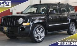 Jeep Patriots are incredibly popular here due to the combination of great fuel economy, roomy interior, classic Jeep styling, and go anywhere four wheel drive. This Patriot shows well with its shiny black paint and white letter tires. Take this one out