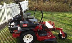 "This mower has been babied, waxed, stored in a heated garage and is in EXCELLENT CONDITION!!! Mower also includes light kid and roller striper kit to make your lawn look like a professional baseball field. SPECIFICS: Mowing Deck: 60"" Motor: Kawasaki Gas"