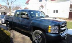2011 Chevrolet Silverado in Excellent Condition Graphite Blue Exterior Titanium Grey Cloth Interior V8 Engine with 28,000 Miles Extended Cab Equipped with Snow Tires Cruise control Retained accessory power Power steering 12V front power outlets Tilt