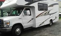 2011 Four Winds Chateau 21RB, V8, Ford E350, super duty awning, sleeps 6, and has A/C. The kitchen has 3 range stove/oven, microwave, fridge, freezer, sink, and dinette (opens to a bed). The living room has a TV, surround sound, DVD/VCR, CD./stereo, cable