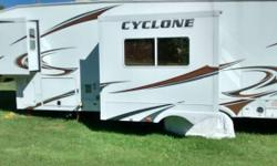 This is an amazing Toy Hauler that is in mint condition. Have to sacrifice, must go don't want to sell but have to. It has a 32 inch TV stereo system in and out , has a good generator, queen size bed and queen bunks, great 5th wheel we are leaving state