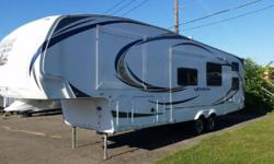 This like new 2012 Forest River Wildcat eXtraLite 312BHX 5th Wheel is in Excellent Condition, has been Smoke & Pet Free, and shoes have always been removed at the door. Used On About 15 Trips. INTERIOR FEATURES: Vinyl Floors, Carpet, Cherry Wood Cabinet,