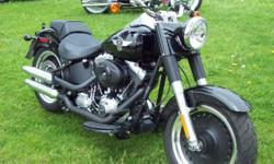 IT IS LIKE NEW AND ALL STOCK!! The 2012 Harley-Davidson® Fat Boy® Lo FLSTFB has all the features you expect on custom Harley® motorcycles. Hearkening to the 'hardtail' choppers of the '60s and '70s, the Fat Boy® Lo is one of the custom Harley® motorcycles