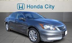 Look at this 2012 Honda Accord Sdn EX. It has an Automatic transmission and an I4 2.4L engine. This Accord Sdn has the following options: Pwr windows w/front auto-up/down, illuminated switches, Security system, 3-point seat belts in all seating positions