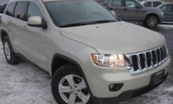 ***CLEAN VEHICLE HISTORY REPORT***, ***ONE OWNER***, ***PRICE REDUCED***, and HEATED LEATHER, SUNROOF AND NAVIGATION. Grand Cherokee Laredo, 5.7L V8 Multi Displacement VVT, 4WD, Gold, and Black Cloth. Looking for a tremendous deal on a handsome-looking