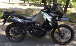 Black/graphite, 3,600 on road-only easy miles. Sargent seat, Givi tinted windscreen. Stock seat and windshield included. 12 volt receptacle in upper fairing. Otherwise stock machine ready for add-ons.