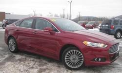 ***CLEAN VEHICLE HISTORY REPORT***, ***ONE OWNER***, and ***PRICE REDUCED***. Fusion Titanium, EcoBoost 2.0L I4 DGI DOHC Turbocharged VCT, 6-Speed Automatic, AWD, and Red. How would you like driving away in this good-looking 2013 Ford Fusion at a price