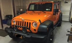 "2013 Jeep Wrangler Unlimited Sport, 5700 Miles. Auto Trans. Teraflex leveling kit, 33"" Goodyear Wrangler DuraTrac tires. Alloy Wheels. Smittybilt Rock Crawler Side Armor , Brush Guard, Fog Lights, JVC Stereo, Upgraded speakers ,amp, subwoofer. Electric"