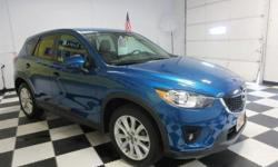 To learn more about the vehicle, please follow this link: http://used-auto-4-sale.com/108522096.html This 2013 Mazda CX-5 Grand Touring will sell fast Backup Camera, Bluetooth, Leather Seats, Auto Climate Control, Satellite Radio, Multi-Zone Air