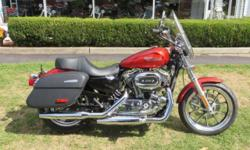 JUST LIKE NEW--STILL UNDER FACTORY WARRANTY 2014 Harley-Davidson® Sportster® SuperLow®.The 2014 Harley-Davidson® Sportster® SuperLow 1200T motorcycle is a new Sportster® motorcycle that packs full-on touring capability into a low riding, easy handling