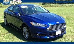 To learn more about the vehicle, please follow this link: http://used-auto-4-sale.com/108699706.html Ford certified! 2016 Ford Fusion Titanium in Deep Impact Blue, Bluetooth for Phone and Audio Streaming, Heated Leather Seats, 33 Miles Per Gallon, 12