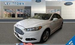 To learn more about the vehicle, please follow this link: http://used-auto-4-sale.com/108571454.html Only 4,549 Miles! Scores 36 Highway MPG and 40 City MPG! Carfax One-Owner Vehicle. This Ford Fusion Energi boasts a Gas/Electric I-4 2.0 L/122 engine