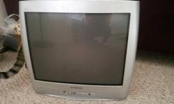 Selling a 21 inch Magnavox television, in good shape, but does have a small scratch/crack toward the bottom of the screen and some dings on the side (see photos). Has a lot of life left in it - does not have a remote - would work well for a guest room or