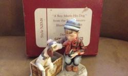 A Boy meets his dog == in good condition -displayed on shelve for many years Fine Bone China Figurine inspired by Norman Rockwell's ==This figure inspired by Norman Rockwell's Brown & Bigelow Calendar of 1958 Pride Of Parenthood Style NRM8. These